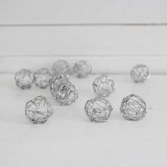 12 mini pelotes en métal argent
